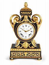 PENDULE Par Pierre II GILLE (1723-1784)Reçu Maître Horloger en 1748 Paris, époque Louis XVI, vers 1780 MATÉRIAUX: Ebène, bronzes dorés, émail et verre Mouvement et cadran signé Gille L'Ainé H. 56 cm, L. 31 cm, P. 21 cm