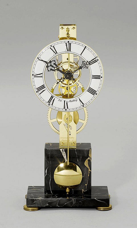 A SMALL SKELETON CLOCK, the dial signed ED MATHEY,