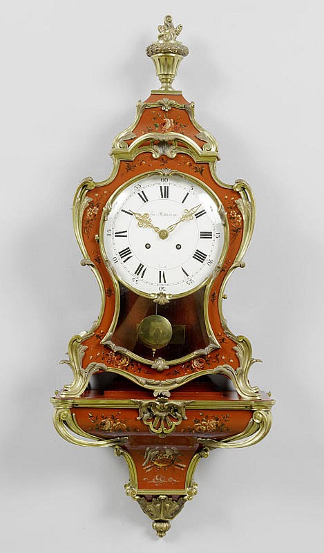 CLOCK ON PLINTH, Louis XV style. The dial signed