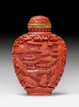 A CINNABAR LACQUER SNUFF BOTTLE CARVED WITH LANDSCAPES.