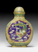 A CLOIOSONNÉ ENAMEL SNUFF BOTTLE DECORATED WITH DRAGON AND PHOENIX.