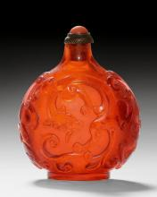 A TRANSPARENT RED GLASS SNUFF BOTTLE CARVED WITH CHILONG.