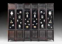 A FINE SIX-FOLD HARDWOOD AND LACQUER SCREEN INLAID WITH JADE AND OTHER STONES.
