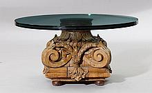 A SALON TABLE WITH GLASS TOP, Baroque style.