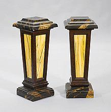 A PAIR OF MARBLED PEDESTALS, Baroque style.
