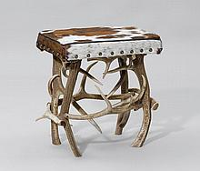 ANTLER STOOL,Alpine region. White/brown cow skin