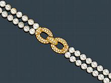 PEARL AND DIAMOND SAUTOIR WITH BRACELET.Yellow