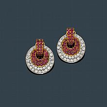 RUBY AND DIAMOND EAR CLIPS.Yellow and white gold