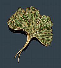 TSAVORITE AND GOLD BROOCH, HEMMERLE.Yellow gold