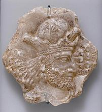 RELIEF FRAGMENT WITH THE HEAD OF A KING,