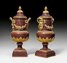 PAIR OF PORPHYRY VASES 'AUX MASCARONS', in the