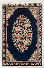 GHOM. Dark blue central field with a floral