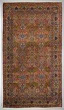 KERMAN antique.Central field patterned with floral medallio