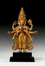 A GILT BRONZE FIGURE OF THE ELEVEN HEADED