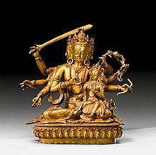 A GILT COPPER FIGURE OF DHARMADHATU VAGISHVARA