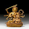 A GILT COPPER FIGURE OF DHARMADHATU VAGISHVARA