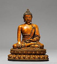 A LACQUER GILT WOOD FIGURE OF BUDDHA SHAKYAMUNI.