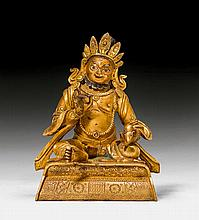 A GILT BRONZE FIGURE OF THE GOD OF WEALTH KUBERA.