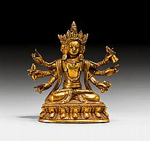 A GILT BRONZE MINIATURE FIGURE OF A SIX ARMED
