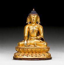 A GILT COPPER FIGURE OF THE CROWNED BUDDHA