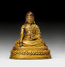 A GILT COPPER FIGURE OF A HIGH LAMA. Tibet, 17th