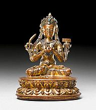 A GILT COPPER FIGURE OF MANJUSHRI WITH GLASS