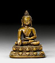 A SMALL AND CUTE BRONZE FIGURE OF SHAKYAMUNI.
