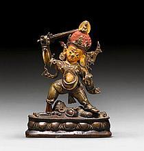 A BRONZE FIGURE OF ACALA SUBDUING VINAYAKA. Tibet,