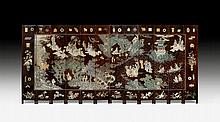 A TWELVE PANEL COROMANDEL LACQUER SCREEN WITH THE