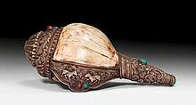 A SHANKA CONCH TRUMPET WITH SILVER MOUNTS. Tibet,