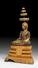A GILT AND BLACK LACQUER BRONZE FIGURE OF THE