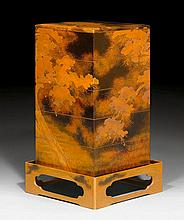 A GOLD AND BLACK LACQUERED FIVE-TIERED JUBAKO AND