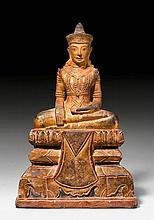 A GOLD LACQUERED SANDSTONE FIGURE OF THE CROWNED
