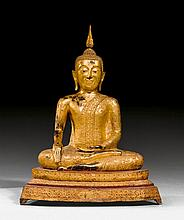 A RED AND GILT LACQUER BRONZE FIGURE OF THE SEATED