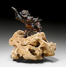 A BRONZE FIGURE OF AN ONI HOLDING A BRUSH. Japan,