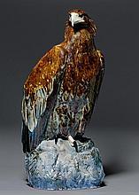 VILHELM THEODOR FISCHER FÜR ROYAL COPENHAGEN  (1857-1928)  GROSSE FIGUR, dat. 1921  Porzellan farbig staffiert. Steinadler auf einem Felsen. Signiert Vilh. Th. Fischer, G-Z-1921, mit Wellenmarke und Krone. H. 74 cm.