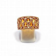 CITRIN-DIAMANT-RING.Roségold 750.Attraktiver Bandring, die Schauseite mit diamantbesetzten Mäandermotiven, verziert mit 11 tropfenförmigen Citrinen von zus. ca. 2.30 ct. Gesamtgewicht der Diamanten ca. 0.50 ct. Gr. ca. 53.