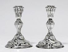 PAIR OF CANDLESTICKS,20th century.Curved foot with
