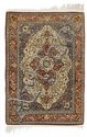 HEREKE SILK.White ground with a red central
