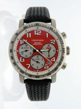 Mens Chopard Rossa Corsa Titanium chronograph   watch. Limited edition only 1000 pieces made.  Red  Chronograph dial date between 4 and 5:00  tachymetric scale bezel.  Water resistant: 50 m  Diameter: 40.5 mm . Rubber tire band, tang buckle. Comes with  manufacture box and booklets. Shipping $32.00
