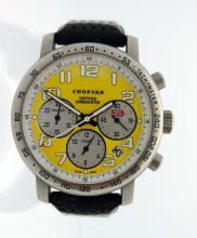 Mens Chopard Rossa Corsa Titanium chronograph   watch. Limited edition only 1000 pieces  made.  Yellow Chronograph dial date between 4  and 5:00 tachymetric scale bezel.  Water  resistant: 50 m Diameter: 40.5 mm . Rubber tire band, tang buckle. Comes with  manufacture box and booklets. Shipping $32.00