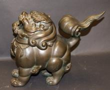 A 19th Century Chinese cast bronze Fo dog-form censer, removable head and verdigris patina