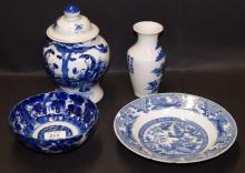 A selection of oriental blue and white ceramics including an early jar and cover.