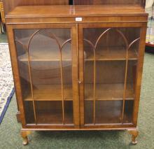A mahogany two door glazed bookcase