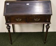 A 19th Century oak fall-front bureau of small proportions