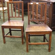 A pair of early 18th century oak chairs