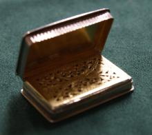 Nathaniel Mills, a hallmarked silver snuff box, with pierced grill and gilt-washed interior