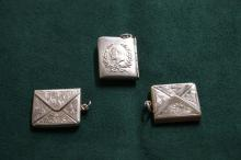 Three silver stamp holders