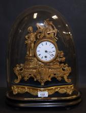 French gilt spelter-cased mantel clock with a circular enamelled dial together with gilt wood stand and glass dome and stand