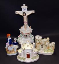 Three Staffordshire flatback ceramic buildings, a Staffordshire flatback figural group and a Staffordshire flatback depiction of Christ's crucifixion (A/F)
